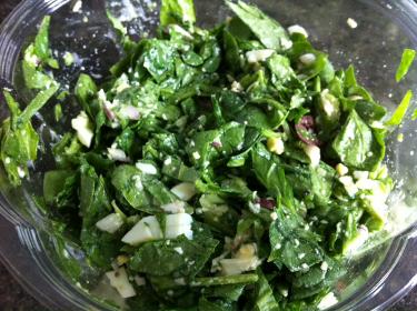 Chop't salad with spinach, olives, eggs, onions, cucumber and caesar dressing